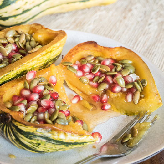 Delicata Squash with Honey, Pomegranate Seeds and Pepitas